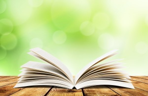 Open-book-on-green-background