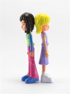 Two teenage dolls back to back isolated on white background