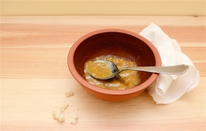 Empty soup bowl with crumbs and a used linen napkin