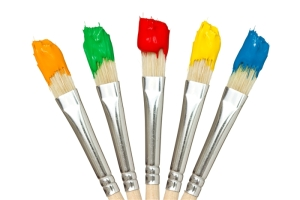 Five paintbrushes with color paints. Isolated on white background.