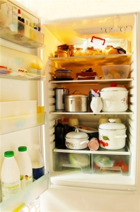 opened refrigerator inside full of various foodstuff
