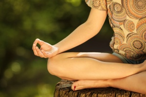 Young female meditate in nature.Close-up image.