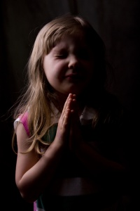 Child saying prayers