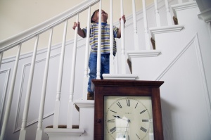 Young boy climbing stairs