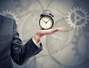 Concept of time with businessman that hold an alarm clock