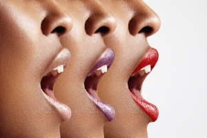 three woman's profiles with different lip color